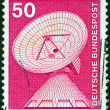 "GERMANY - CIRCA 1975: A stamp printed in Germany from the ""Industry and Technology"" issue shows a telecommunications dish, circa 1975. - Stock Photo"