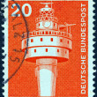 "GERMANY - CIRCA 1975: A stamp printed in Germany from the ""Industry and Technology"" issue shows a Modern lighthouse, circa 1975. - Stock Photo"