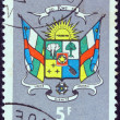 CENTRAL AFRICAN REPUBLIC - CIRCA 1965: A stamp printed in Central African Republic shows Coat Of Arms, circa 1965. - Stock Photo