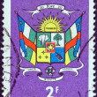 CENTRAL AFRICAN REPUBLIC - CIRCA 1965: A stamp printed in Central African Republic shows Coat Of Arms, circa 1965. — Stock Photo #11067375