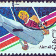 "USA - CIRCA 1983: A stamp printed in USA from the ""Summer Olympic Games, Los Angeles 1984"" issue shows a flying rings athlete, circa 1983. - Stock Photo"
