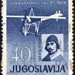 YUGOSLAVIA - CIRCA 1960: A stamp printed in Yugoslavia issued for the 50th anniversary of 1st flight in Yugoslavia shows Edvard Rusjan and his airplane, circa 1960. - Stock Photo