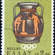 GREECE - CIRCA 1968: A stamp printed in Greece issued for the lighting of the Olympic Flame for the 1968 summer Olympics of Mexico shows an Olympic scene on Attic vase, circa 1968. — Stock Photo