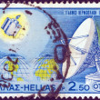 GREECE - CIRCA 1970: A stamp printed in Greece shows a satellite and an aerial dish from the Satellite Earth Telecommunications Station, Thermopylae, circa 1970. — Stock Photo