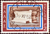 """GREECE - CIRCA 1968: A stamp printed in Greece issued for the 20th anniversary of Dodecanese union with Greece shows """"the unknown priest and teacher"""" monument at Rhodes island, circa 1968. — Stock Photo"""