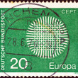 "GERMANY - CIRCA 1970: A stamp printed in Germany from the ""Europa"" issue shows a flaming sun, circa 1970. — Stock Photo"