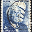 "USA - CIRCA 1965: A stamp printed in USA from the ""Prominent Americans (1st series)"" issue shows architect Frank Lloyd Wright and Guggenheim Museum, New York, circa 1965. — Stock Photo"