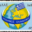 "GREECE - CIRC1977: stamp printed in Greece from ""Greeks Abroad"" issue shows Globe and Greek flag, circ1977. — Stock Photo #11176479"