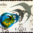 "GREECE - CIRC1977: stamp printed in Greece from ""Greeks Abroad"" issue shows Globe and swallows, circ1977. — Stock Photo #11176487"
