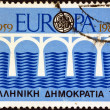 "GREECE - CIRCA 1984: A stamp printed in Greece from the ""Europa. 25th anniversary of C.E.P.T."" issue shows a bridge, circa 1984. — Stock Photo"
