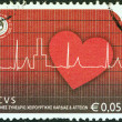 Stock Photo: GREECE - CIRC2005: stamp printed in Greece issued for 54th Congress of Europesociety for cardiovascular surgery, shows heart and cardiogram, circ2005.