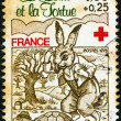FRANCE - CIRCA 1978: A stamp printed in France from the &amp;quot;Red Cross Fund. Fables of La Fontaine&amp;quot; issue shows &amp;quot;The Hare and the Tortoise&amp;quot;, circa 1978. - Stock Photo