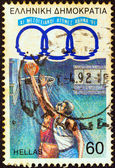 "GREECE - CIRCA 1991: A stamp printed in Greece from the ""11th Mediterranean Games, Athens"" issue shows basketball players, circa 1991. — Stock Photo"