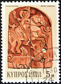 CYPRUS - CIRCA 1971: A stamp printed in Cyprus shows a wood carving of Saint George and Dragon (19th century bass-relief), circa 1971. — Stock Photo