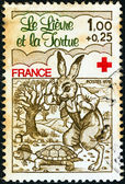 "FRANCE - CIRCA 1978: A stamp printed in France from the ""Red Cross Fund. Fables of La Fontaine"" issue shows ""The Hare and the Tortoise"", circa 1978. — Stock Photo"