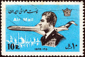 IRAN - CIRCA 1972: A stamp printed in Iran shows Mohammad Reza Shah Pahlavi and airplane, circa 1972. — 图库照片