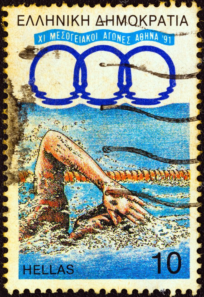 "GREECE - CIRCA 1991: A stamp printed in Greece from the ""11th Mediterranean Games, Athens"" issue shows a swimmer, circa 1991. — Stock Photo #11176505"