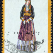 "GREECE - CIRCA 1974: A stamp printed in Greece from the ""Traditional Greek Costumes 3rd part"" issue shows a woman with traditional clothing from Naoussa, Macedonia, circa 1974. — Stock Photo"