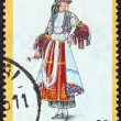 "GREECE - CIRCA 1974: A stamp printed in Greece from the ""Traditional Greek Costumes 3rd part"" issue shows a woman with traditional ""karagouniki"" clothing from Thessaly, circa 1974. — Stock Photo"