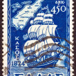 "GREECE - CIRCA 1947: A stamp printed in Greece from the ''Dodecanese integration"" issue shows a sailing ship and a map of Kasos island, Dodecanese, circa 1947. — Stock Photo"