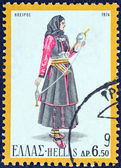 "GREECE - CIRCA 1974: A stamp printed in Greece from the ""Traditional Greek Costumes 3rd part"" issue shows a woman from Epirus, circa 1974. — Stock Photo"