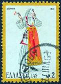Греция - около 1974: марку, напечатанную в Греции от вопроса «традиционные греческие костюмы 3-часть» показывает женщину от desfina, Фокида, около 1974. — Стоковое фото