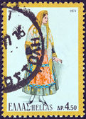 """GREECE - CIRCA 1974: A stamp printed in Greece from the """"Traditional Greek Costumes 3rd part"""" issue shows a woman from Thassos island, circa 1974. — Stock Photo"""