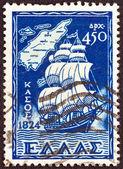 """Yunanistan - 1947 yaklaşık: Yunanistan'ın '' Oniki Ada entegrasyon""""sorundan basılmış damga bir yelkenli gemi ve bir harita, kasos Adası, Oniki Ada, 1947 yaklaşık gösterir. — Stok fotoğraf"""