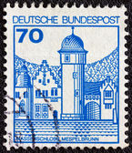 """GERMANY - CIRCA 1977: A stamp printed in Germany from the """"Strongholds and castles"""" issue shows Mespelbrunn castle, circa 1977. — Stock Photo"""