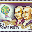 """HUNGARY - CIRCA 1977: A stamp printed in Hungary from the """"Airships"""" issue shows Montgolfier Brothers and Balloon, circa 1977. — Stock Photo #11327328"""