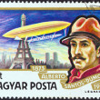 "HUNGARY - CIRCA 1977: A stamp printed in Hungary from the ""Airships"" issue shows Alberto Santos-Dumont and airship Ballon No. 5 over Paris, circa 1977. — Stock Photo"