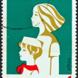 BULGARIA - CIRCA 1974: A stamp printed in Bulgaria issued for the 30th anniversary of Dimitrov's Septembrist Pioneers Organization shows young pioneer and Komsomol girl, circa 1974. — Stock Photo