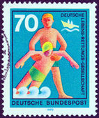 "GERMANY - CIRCA 1970: A stamp printed in Germany from the ""Voluntary Relief Services"" issue shows rescue from drowning, circa 1970. — Stock Photo"