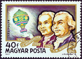 "HUNGARY - CIRCA 1977: A stamp printed in Hungary from the ""Airships"" issue shows Montgolfier Brothers and Balloon, circa 1977. — Stock Photo"