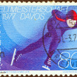 SWITZERLAND - CIRCA 1976: A stamp printed in Switzerland issued for the World Speed Skating Championships, Davos, 1977 shows a skater, circa 1976. — Stock Photo #11349014