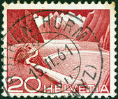 SWITZERLAND - CIRCA 1949: A stamp printed in Switzerland shows Grimsel Reservoir, circa 1949. — Stock Photo
