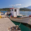 Traditional Greek fishing boat at Archaia Epidaurus harbor, Greece - Stock Photo
