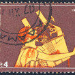 "GREECE - CIRCA 1975: A stamp printed in Greece from the '""traditional musical instruments"" issue shows an ancient guitar player, circa 1975. — Stock Photo"