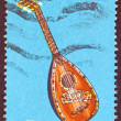 "GREECE - CIRCA 1975: A stamp printed in Greece from the '""traditional musical instruments"" issue shows a lute (laouto), circa 1975. — Stock Photo"