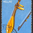 "GREECE - CIRCA 1975: A stamp printed in Greece , from the '""traditional musical instruments"" issue shows a Cretan lyra, circa 1975. — Stock Photo"