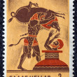 "GREECE - CIRCA 1970: A stamp printed in Greece, from the ''Hercules"" issue shows Hercules capturing the Erymanthian Boar, circa 1970. - Stock Photo"