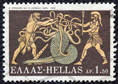 "GREECE - CIRCA 1970: A stamp printed in Greece, from the ''Hercules"" issue shows Hercules killing Lernaean Hydra, circa 1970. — Stock Photo"