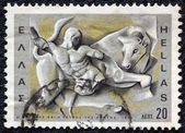 "GREECE - CIRCA 1970: A stamp printed in Greece, from the ''Hercules"" issue shows Hercules and the Cretan bull, circa 1970. — Stock Photo"