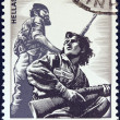 "GREECE - CIRCA 1982: A stamp printed in Greece from the ""National Resistance, 1941-44"" issue shows resistance fighters, circa 1982. - Stock Photo"