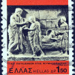 "GREECE - CIRCA 1977: A stamp printed in Greece from the ""1977, International Rheumatism Year"" issue shows Asclepius curing a young man (relief), circa 1977. — Stock Photo"