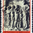 "GREECE - CIRCA 1977: A stamp printed in Greece from the ""1977, International Rheumatism Year"" issue shows patients visiting Asclepius (relief), circa 1977. — Stock Photo"