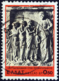 """GREECE - CIRCA 1977: A stamp printed in Greece from the """"1977, International Rheumatism Year"""" issue shows patients visiting Asclepius (relief), circa 1977. — Stock Photo"""