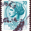 "ITALY - CIRCA 1953: A stamp printed in Italy from the ""Italy turreted (Syracuse)"" issue shows an Ancient coin of Syracuse, circa 1953. - Stock Photo"