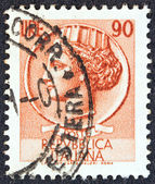 "ITALY - CIRCA 1958: A stamp printed in Italy from the ""Italy turreted (Syracuse)"" issue shows an Ancient coin of Syracuse, circa 1958. — Stock Photo"