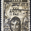 "SPANISH SAHARA - CIRCA 1965: A stamp printed in Spain shows a woman in traditional outfit and and the inscription ""25 years of peace"", circa 1965. — Stock Photo #11543703"